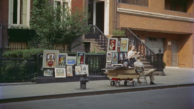 1955 ws two people on sidewalk beside outdoor art market / manhattan, new york - 1955 stock videos & royalty-free footage