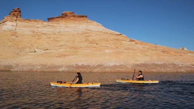 two people paddling kayaks - peruvian ethnicity stock videos & royalty-free footage