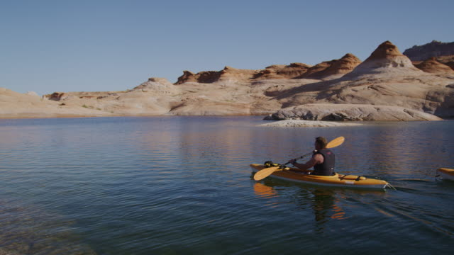 two people paddling kayaks - peruvian ethnicity stock videos & royalty-free footage