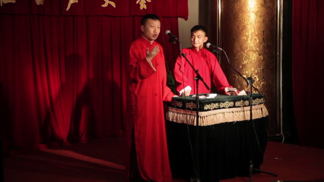 ms two people performing cross talk traditional chinese comic talk show audio / xi'an, shaanxi, china - talk show stock videos & royalty-free footage
