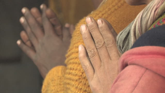CU, SELECTIVE FOCUS, Two people praying, close-up of clasped hands, Allahabad, Uttar Pradesh, India