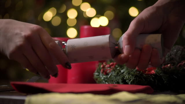 two people pull a christmas cracker - cracker stock videos and b-roll footage
