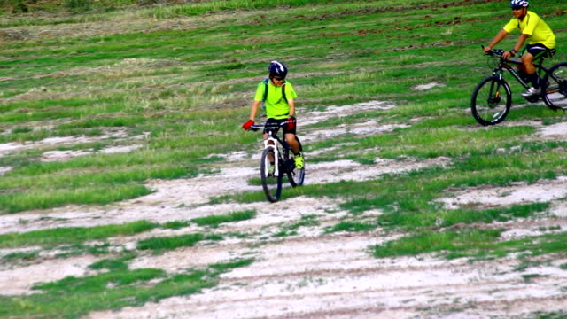 two people ride bicycle off road - bicycle trail outdoor sports stock videos & royalty-free footage