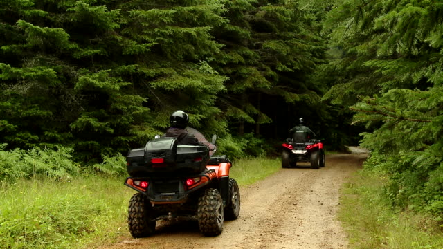two people rides on atv on a dirt trails - quadbike stock videos & royalty-free footage
