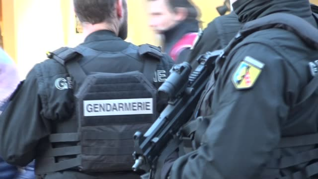 two people shot dead in attack on christmas market in strasbourg suspect still on the run france strasbourg police officers and armed police officers... - 仮設追悼施設点の映像素材/bロール