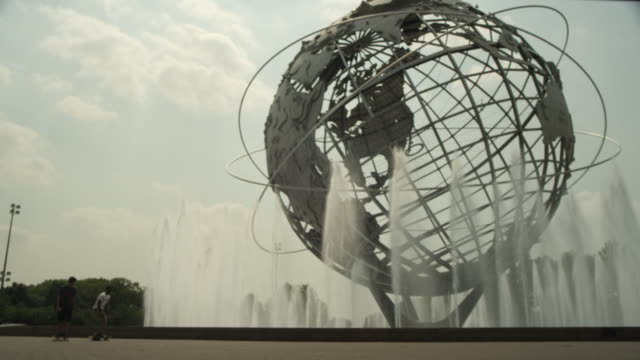 ms two people skateboard in front of the unisphere at flushing meadows park in queens / new york city, new york - flushing meadows corona park stock videos and b-roll footage