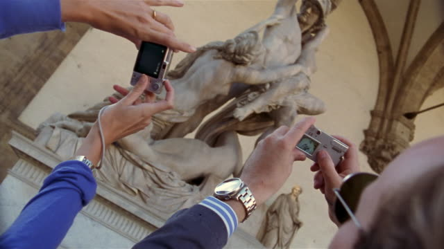 two people taking photos of statue with digital cameras in the uffizi gallery / florence, italy - digital camera stock videos & royalty-free footage