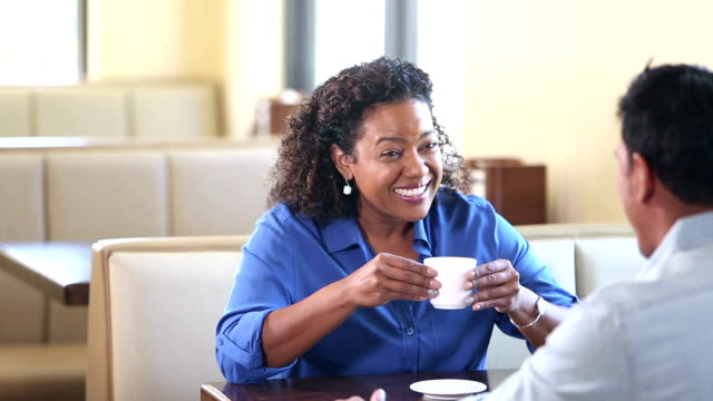two people talking over coffee - casual clothing stock videos & royalty-free footage