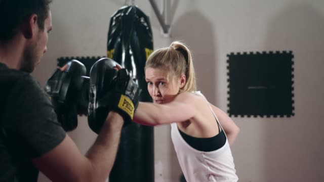 two people training box together - kickboxing stock videos & royalty-free footage
