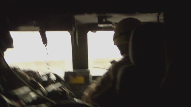 vidéos et rushes de two people travelling in vehicle / musa qala, helmand province, afghanistan. - opération enduring freedom