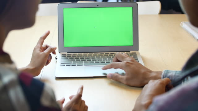 two people using laptop green screen - over the shoulder stock videos & royalty-free footage
