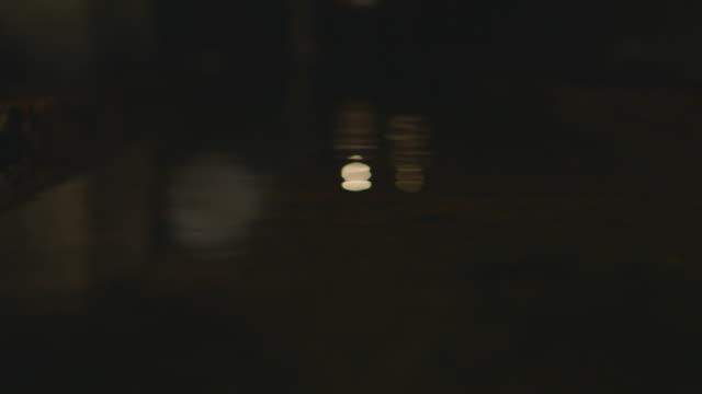 vídeos de stock, filmes e b-roll de two people walk along a dark mine shaft on the island of el hierro. - hierro