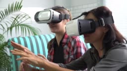 Two people wearing VR glasses at home