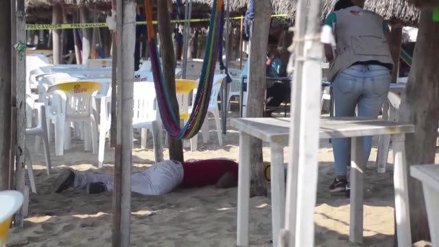 two people were shot dead in broad daylight at a beach in acapulco mexico's crime ridden pacific resort facing local and canadian tourists - pacific war stock-videos und b-roll-filmmaterial