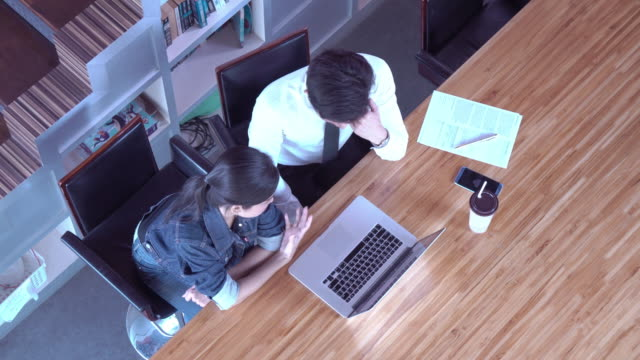 two people working meeting top view. - two people stock videos & royalty-free footage