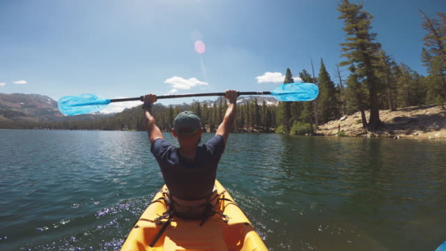 pov of two persons kayaking in a calm lake - mammoth lakes video stock e b–roll