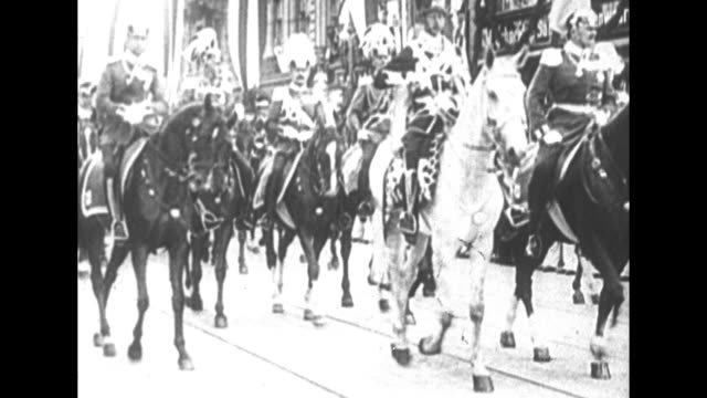 cu two photograph portraits of wilhelm ii / wilhelm in military uniform riding horse down street with other officers riding horses formation of... - schwarzweiß bild stock-videos und b-roll-filmmaterial