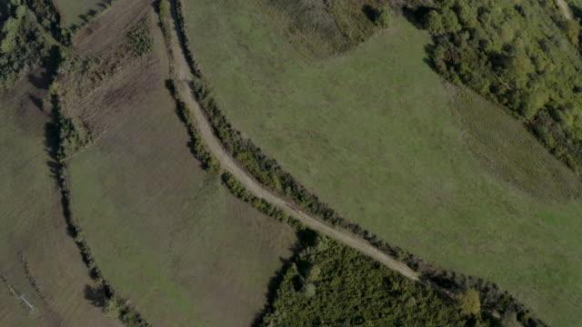 vídeos y material grabado en eventos de stock de two pilgrims walking on the way of saint james near galicia aerial view - camino santiago