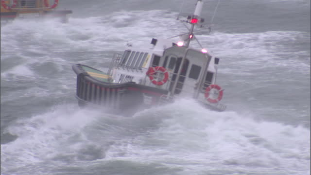 two pilot boats travel on a stormy sea. - storm stock videos & royalty-free footage
