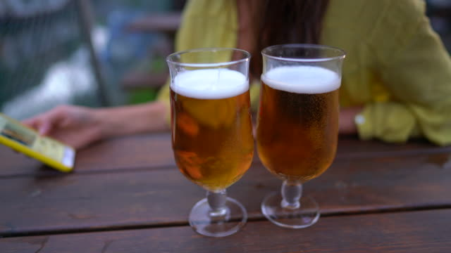 two pints of beer on the table - pint glass stock videos & royalty-free footage
