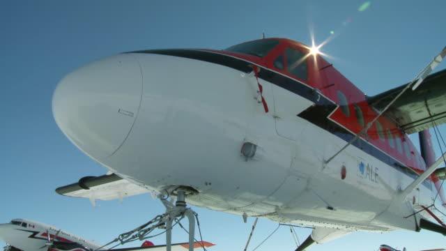 ms la of two planes parking in snowy landscape / union glacier, heritage range, ellsworth mountains, antarctica - antarctica night stock videos & royalty-free footage