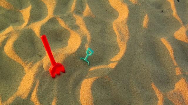 CU, Two plastic shovels in sand, Provincetown, Massachusetts, USA