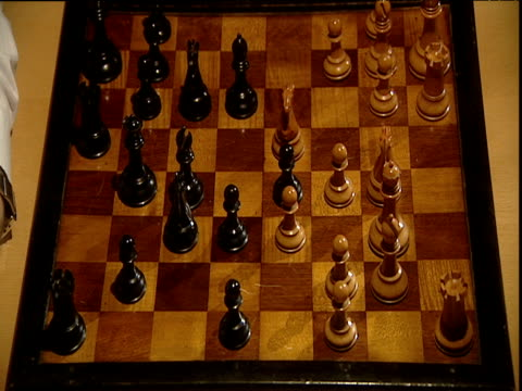 two players make moves during game of chess - chess stock videos & royalty-free footage