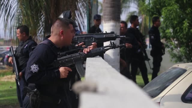 two police officers and two alleged criminals died in a shootout in tlajomulco a suburb of guadalajara in western mexico local authorities report - criminal stock videos & royalty-free footage