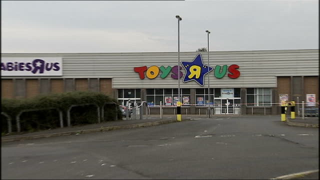 two police officers injured in belfast bomb attack; northern ireland: belfast: ext general views fo toys r us store with police cordon tape outside... - toys r us stock videos & royalty-free footage