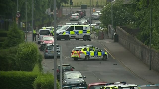 Two police officers injured in knife attack in Greenock SCOTLAND Inverclyde Greenock EXT Police officers police cars and police tape cordons in...