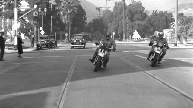 two police officers on motorcycles travel on hollywood boulevard in hollywood, california. - 1933 stock videos & royalty-free footage