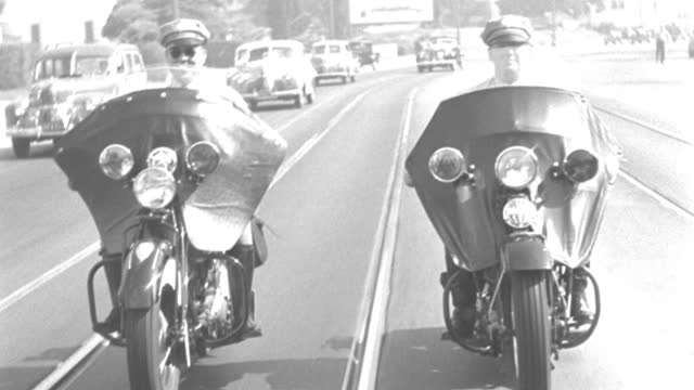 two police officers ride motorcycles down highland avenue in hollywood. - 1941 stock videos & royalty-free footage