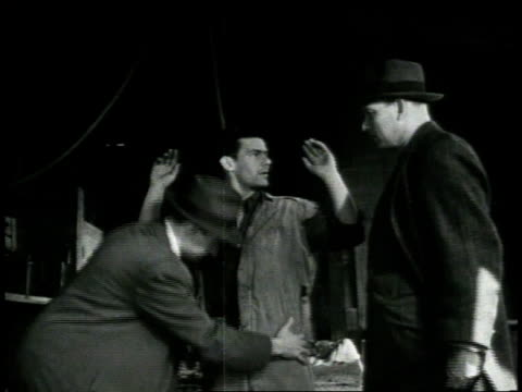 vidéos et rushes de 1948 b/w two policemen frisking suspect, leading him away / new york city, new york, united states - demander