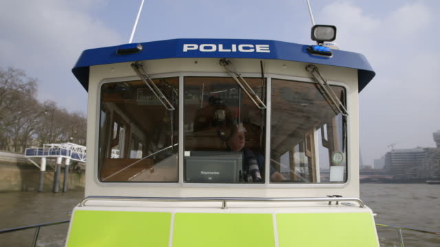 ms pov two policemen in police boat on river thames by blackfriars millennium pier / london, england, united kingdom - police boat stock videos and b-roll footage