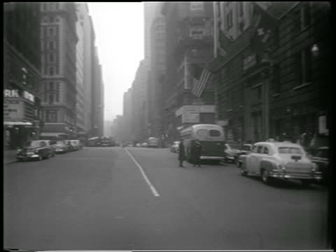 b/w 1951 two policemen stand on empty nyc street during civil defense drill / newsreel - 1951 stock videos & royalty-free footage