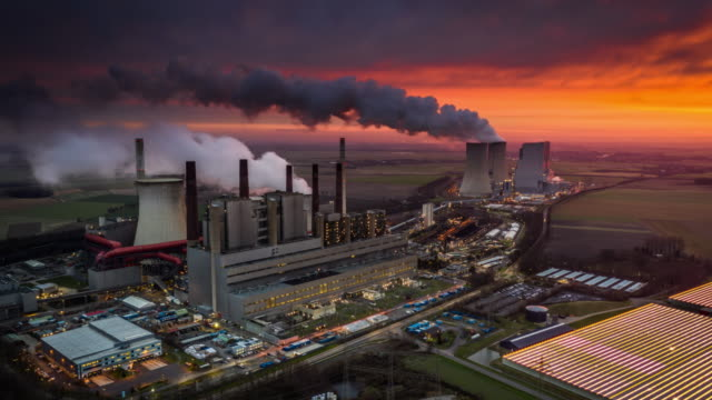 two power stations at sunrise - hyperlapse - coal fired power station stock videos & royalty-free footage