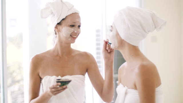 two pretty women applying a facial mask - spa stock videos & royalty-free footage