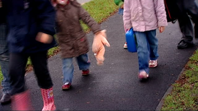 Two primary schools have SATS results annulled ENGLAND Hemel Hempstead Brockswood Primary School EXT Pupils and parents arriving at school entrance...