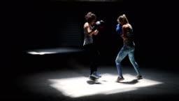 Two professional kick boxers sparring with each other