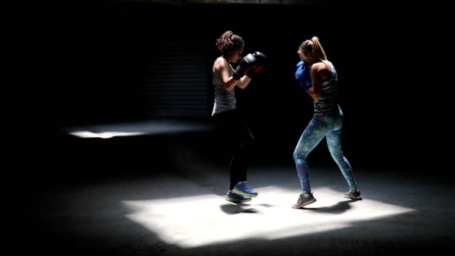 two professional kick boxers sparring with each other - kickboxing stock videos and b-roll footage