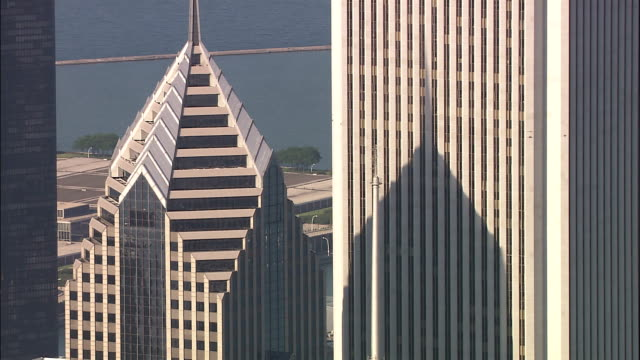 two prudential plaza casts a shadow on an adjacent skyscraper. - two prudential plaza stock videos & royalty-free footage