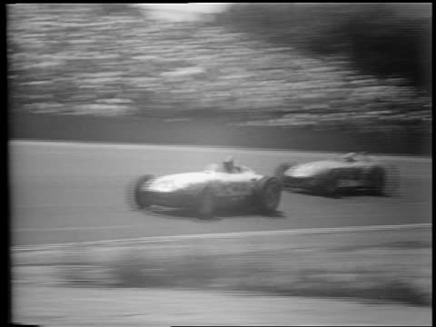 pan two race cars speeding past camera in indianapolis 500 / car spinning out - 1953 stock videos and b-roll footage