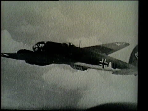two raf pilots engage in a dogfight with a member of the luftwaffe and score a kill as the plane crashes into the english channel. - luftwaffe stock-videos und b-roll-filmmaterial