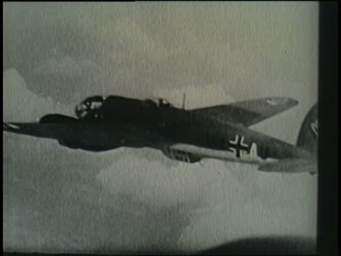 stockvideo's en b-roll-footage met two raf pilots engage in a dogfight with a member of the luftwaffe and score a kill as the plane crashes into the english channel. - nazism