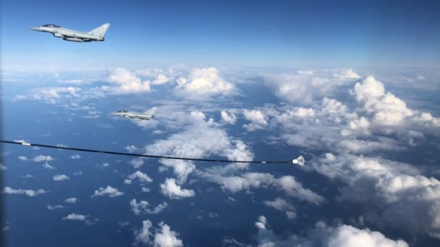 two raf typhoon combat aircraft leave the area after refueling from an raf voyager aircraft over the north sea on october 08, 2020 in flight, above... - refuelling stock videos & royalty-free footage