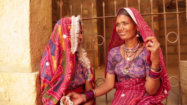 Two rajasthani women smiling, Jaisalmer, Rajasthan, India