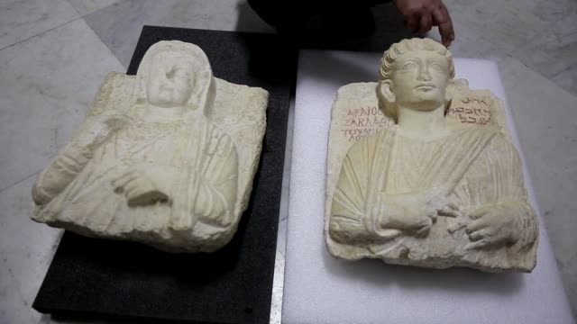 Two rare busts rescued from the Islamic State group in the ancient city of Palmyra and restored in Italy have been returned to Syria the country's...