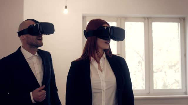two real estate agents using vr headset - selling stock videos & royalty-free footage