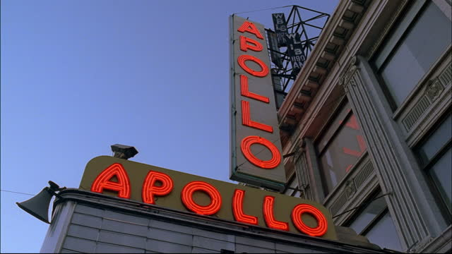 two red neon signs mark new york city's famous apollo theater. - red tape stock videos & royalty-free footage