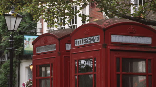 cu two red telephone booths / richmond, london, united kingdom - fianco a fianco video stock e b–roll